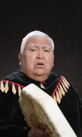 Bob George, First Nations elder, in First Nations garment playing an instrument [4 of 36 photogra...