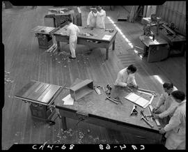 B.C. Vocational School image of the inside of the Carpentry Trades shop with students working at ...