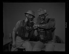 Two men wearing gas masks, BCIT Mining Program