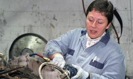BCIT women in trades; BC Transit, student in uniform while working on a motor engine [2 of 8 phot...