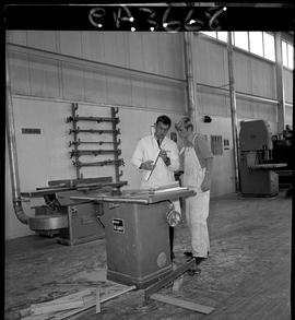 B.C. Vocational School; inside of the Carpentry Trades shop with a student and instructor standin...