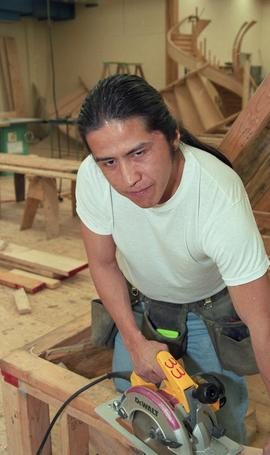 First Nations student wearing a tool belt and using a woodworking tool [11 of 13 photographs]