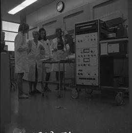 Medical isotope,  Nuclear medicine technology, 1971; instructor and students talking and standing...