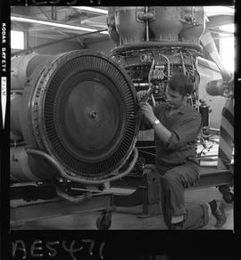 BC Vocational School; Aeronautics student working on an aircraft engine inside the hangar in Burnaby
