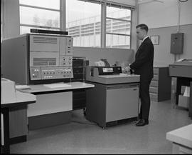 Man working with IBM 2501, Business Management program